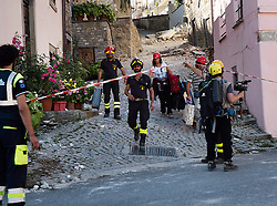 © London News Pictures. 25/08/2016. Amatrice, Italy. Rescuers are seen in the town of Amatrice in central Italy where a 6.2-magnitude earthquake destroyed towns in the area. The death toll is currently at 247 with dozens of people still missing. Thousands of rescuers continue efforts to find survivors. Photo credit: Mario Sabatini/LNP