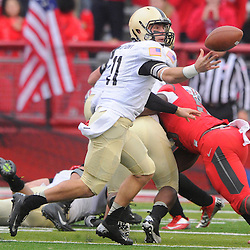 10 November 2012: Army Black Knights quarterback A.J. Schurr (11) loses control of the ball during NCAA college football action between the Rutgers Scarlet Knights and Army Black Knights at High Point Solutions Stadium in Piscataway, N.J.. Rutgers defeated Army 28-7.