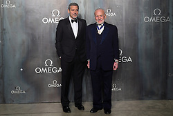 George Clooney and Buzz Aldrin (right) attending the Lost in Space event to celebrate the 60th anniversary of the OMEGA Speedmaster held in the Turbine Hall, Tate Modern, 25 Sumner Street, Bankside, London.