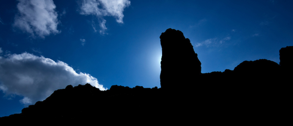 The rock formation Old Man of Storr silhouetted against cloudy sky on the Isle of Skye, Scotland, UK