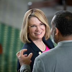 Texas Senate action on Tuesday, May 18, 2021 showing  Sen. Dawn Buckingham, R-Lakeway, talking with Rep. Jarvis Johnson,  D-Houston.