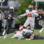 ORLANDO, FL - AUGUST 29: Otis Anderson #2 of the UCF Knights scrambles past Demetrius Powell #45 of the Florida A&M Rattlers during a NCAA football game on August 29 2019 in Orlando, Florida. (Photo by Alex Menendez/Getty Images) *** Local Caption *** Otis Anderson; Demetrius Powell