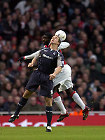 Photo: Olly Greenwood.<br />Arsenal v Bolton Wanderers. The FA Cup. 28/01/2007. Bolton's Kevin Nolan and Arsenal's Kolo Toure