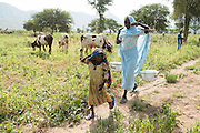 Fatime Abdramane, 30, walks alongside her daughter Nafaye, 6, as she carries water back home from a UNICEF-sponsored water pump in the village of Game, Guera province, Chad on Tuesday October 16, 2012.