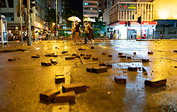 Hong Kong. 6 October 2019. Tens of thousands of pro-democracy protestors march in pouring rain through centre of Hong Kong today from Causeway Bay to Central. Peaceful march later turned violent as a hard-core of protestors confronted police. Pic; Bricks on street in Wanchai district.Iain Masterton/Alamy Live News.