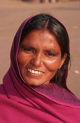 Portrait of woman wearing traditional dress smiling,