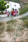 Elders talk around the pond at sunset, Tamaraikulum Elders village, Tamil Nadu, India