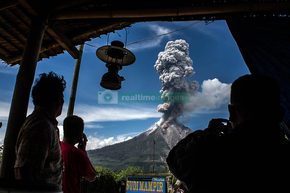 February 4, 2017 - Karo, North Sumatra, Indonesia - A resident watched Sinabung as releasing a cloud of hot ash vulcanic showed signs of volcanic activity in the area remains high, during eruption in Karo. Sinabung roared back to life in 2010 for the first time in 400 years and after another period of inactivity, it erupted once more in 2013 and has remained highly active since and last erupted in May 2016, killing seven people. (Credit Image: © Ivan Damanik via ZUMA Wire)