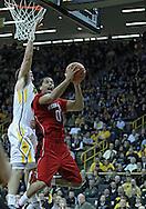 January 26, 2012: Nebraska Cornhuskers guard Toney McCray (0) puts up a shot past Iowa Hawkeyes guard/forward Eric May (25) during the NCAA basketball game between the Nebraska Cornhuskers and the Iowa Hawkeyes at Carver-Hawkeye Arena in Iowa City, Iowa on Thursday, January 26, 2012.