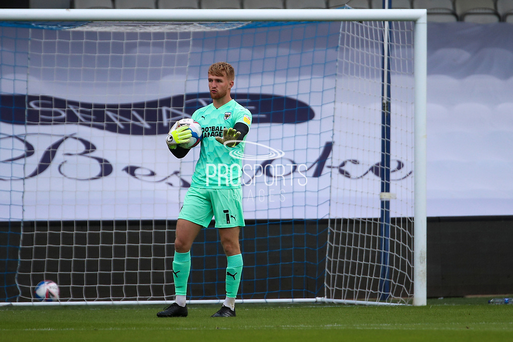 AFC Wimbledon goalkeeper Connal Trueman (1) with ball in hands during the EFL Trophy Group O match between AFC Wimbledon and Charlton Athletic at the Kiyan Prince Foundation Stadium, London, England on 1 September 2020.