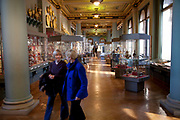 Visitors at the Sacred Silver Galleries. The Victoria and Albert Museum aka the V&A at South Kensington, London. Known as the world's greatest museum of art and design, with collections unrivalled in their scope and diversity. Discover 3000 years' worth of amazing artefacts from many of the world's richest cultures including ceramics, furniture, fashion, glass, jewellery, metalwork, photographs, sculpture, textiles and paintings.