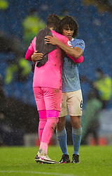 Nathan Ake (R) and Ederson of Manchester City hug at the final whistle - Mandatory by-line: Jack Phillips/JMP - 26/12/2020 - FOOTBALL - Etihad Stadium - Manchester, England - Manchester City v Newcastle United - English Premier League