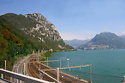 Switzerland, Lugano, Railroad track encircles lake Lugano.