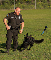Laconia Police Officer Kevin Shortt commands K9 Jagger during Laconia's National Night Out demonstration at Woodland Heights School Tuesday evening.   (Karen Bobotas/for the Laconia Daily Sun)