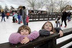 © Licensed to London News Pictures. 26/11/2011. Lamberhurst ,UK. L to R Molly Lewis (4) and Imogen Black (4) ice skating on the opening day of LaplandUK  in Lamberhurst, Kent today (26/11/2011). The park which is recreated from scratch every year, recreates Father Christmas' arctic homeland. Photo credit : Grant Falvey/LNP