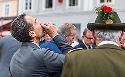 28.07.2016, Residenzplatz, Salzburg, AUT, Salzburger Festspiele, Eroeffnungsakt, im Bild Bundeskanzler Christian Kern (SPOe) beim Schnapstrinken // Federal chancellor Christian Kern (SPOe) during the Opening Ceremony of the Salzburg Festival, it takes place from 22 July to 31 August 2016, at the Residenzplatz in Salzburg, Austria on 2016/07/28. EXPA Pictures © 2016, PhotoCredit: EXPA/ JFK