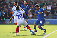 AFC Wimbledon striker Andy Barcham (17) battles for possession with Portsmouth defender Nathan Thompson (20) during the EFL Sky Bet League 1 match between AFC Wimbledon and Portsmouth at the Cherry Red Records Stadium, Kingston, England on 13 October 2018.