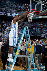 CHAPEL HILL, NC - MARCH 05: Justin Watts #24 of the North Carolina Tar Heels cuts down the net after defeating the Duke Blue Devils and winning the regular season ACC championship on March 05, 2011 at the Dean E. Smith Center in Chapel Hill, North Carolina. North Carolina won 67-81. (Photo by Peyton Williams/UNC/Getty Images) *** Local Caption *** Justin Watts