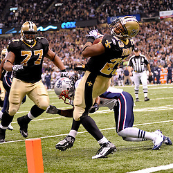 2009 November 30: New Orleans Saints running back Pierre Thomas (23) dives into the endzone in the first half during a 38-17 win by the New Orleans Saints over the New England Patriots at the Louisiana Superdome in New Orleans, Louisiana.