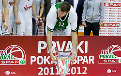 Goran Jagodnik of Olimpija celebrates after winning the basketball match between KK Union Olimpija Ljubljana and KK Krka Novo mesto of finals of 11th Slovenian Spar Cup 2012, on February 19, 2012 in Sports hall Brezice,  Brezice, Slovenia. Union Olimpija defeated Krka 68-63 and became Slovenian Cup Champion 2012. (Photo By Vid Ponikvar / Sportida.com)