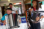 Male Brazilian Gaucho cowboy musicians playing accordians and singing. Gaucho cowboy Rodeo, Flores de Cunha, Rio Grande do Sul.