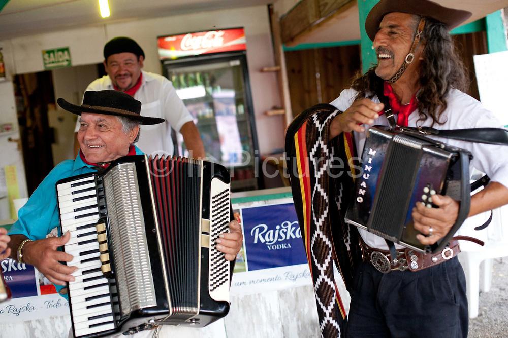 Male Brazilian Gaucho cowboy musicians playing accordians and singing. Gaucho cowboy Rodeo, Flores de Cunha, Rio Grande do Sul.