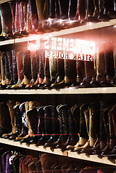 Storefront window at M.L Leddy's Boots, Fort Worth Stockyards National Historic District, Fort Worth, Texas, USA.