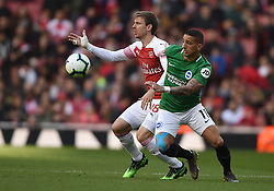 Arsenal's Nacho Monreal and Brighton & Hove Albion's Anthony Knockaert battle for the ball