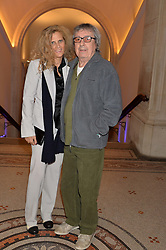 BILL WYMAN and his wife SUZANNE WYMAN at a private view of photographs by David Bailey entitled 'Bailey's Stardust' at the National Portrait Gallery, St.Martin's Place, London on 3rd February 2014.
