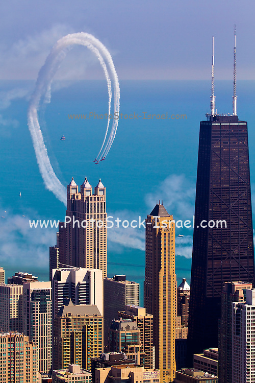 Aerial view of Chicago IL An aerobatic team performing near the John Hancock building. as seen from the Willis tower (formerly Sears tower) observation deck.