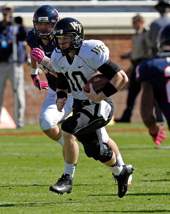 Wake Forest quarterback Tanner Price (10) runs the ball during the game against the Virginia at Scott Stadium in Charlottesville, Va. Wake Forest defeated Virginia 16-10. Wake Forest defeated Virginia 16-10.