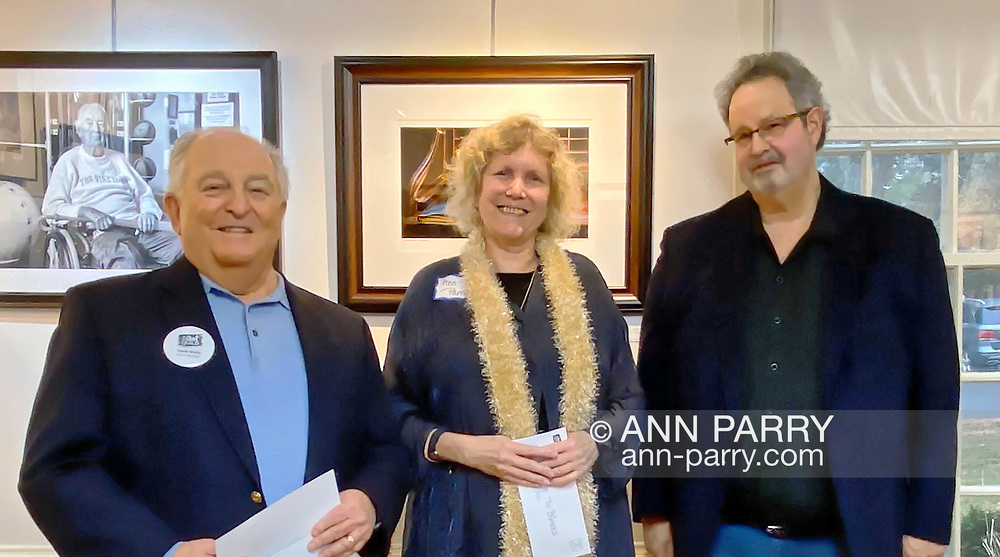 Manhasset, New York, U.S., Feb. 1, 2020. L-R, Board Member DAVE WOLLIN, 1st Place winner ANN PARRY, and Judge HAROLD NAIDEAU pose at The Art Guild exhibition Everything Old is New Again held at Elderfields Preserve.