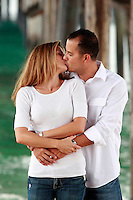 1 August 2008:  Jeff Alba (38), Sue Alba (37),  Husband and Wife kiss each other for a photo under the pier at the beach.