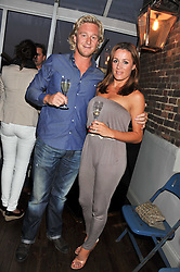 NATHALIE PINKHAM and OWAIN WALBYOFF at a party to celebrate the opening of Bunga Bunga - a new Pizzeria & Bar, 37 Battersea Bridge Road, London SW11 on 1st September 2011.