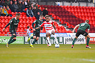 Mallik Wilks of Doncaster Rovers (7) holds the ball away from four Plymnouth players during the EFL Sky Bet League 1 match between Doncaster Rovers and Plymouth Argyle at the Keepmoat Stadium, Doncaster, England on 13 April 2019.