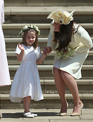 Princess Charlotte and the Duchess of Cambridge on the steps of St George's Chapel in Windsor Castle after the wedding of Prince Harry and Meghan Markle.
