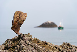 Dunbar, Scotland, UK. 20 April, 2019. Solitary stone balanced on rock at  Eye Cave beach in Dunbar during opening day of the European Stone Stacking Championship 2019.