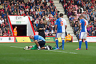Blackburn Rovers goalkeeper, Jake Kean, receives medical treatment whilst fellow teammates Tommy Spurr (R) and Grant Hanley (L) check the situation during the Skybet Championship match, AFC Bournemouth v Blackburn Rovers at The Goldsands Stadium in Bournemouth, England on Saturday 28th September 2013. Picture by Sophie Elbourn/Andrew Orchard Sports Photography.
