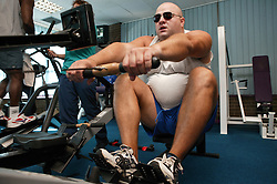 Access to services, Disabled man in the gym; using Rowing Machine,