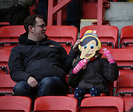 Fans wearing protest masks during the Sky Bet Championship match between Charlton Athletic and Cardiff City at The Valley, London, England on 13 February 2016. Photo by Matthew Redman.