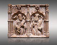 Gothic alabaster relief sculpture of two profits by Pere Oller, circa 1415, from the convent del Carme, Girona, Spain..  National Museum of Catalan Art, Barcelona, Spain, inv no: MNAC 214163. Against a light grey background. .<br /> <br /> If you prefer you can also buy from our ALAMY PHOTO LIBRARY  Collection visit : https://www.alamy.com/portfolio/paul-williams-funkystock/gothic-art-antiquities.html  Type -     MANAC    - into the LOWER SEARCH WITHIN GALLERY box. Refine search by adding background colour, place, museum etc<br /> <br /> Visit our MEDIEVAL GOTHIC ART PHOTO COLLECTIONS for more   photos  to download or buy as prints https://funkystock.photoshelter.com/gallery-collection/Medieval-Gothic-Art-Antiquities-Historic-Sites-Pictures-Images-of/C0000gZ8POl_DCqE