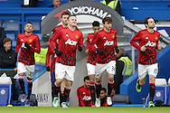 Wayne Rooney, the Manchester United captain leads out his players for pre match warm up. Barclays Premier league match, Chelsea v Manchester Utd at Stamford Bridge in London on Sunday 7th February 2016.<br /> pic by John Patrick Fletcher, Andrew Orchard sports photography.