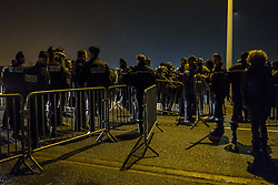October 24, 2016 - Calais, France - The police installed barriers in front of the hangar. Refugees arrive early and wait in front of the hangar distribution of refugees with their luggage in Calais, France on october 24, 2016. The dismantling of the jungle began Monday morning. Refugees come accompanied by the associations to the starting center ''C.A.O.''. Police frames the device. More than 850 press credentials were distributed. (Credit Image: © Julien Pitinome/NurPhoto via ZUMA Press)