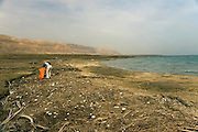 Israel, Dead Sea, volunteers cleaning the beach. The low water level can be seen