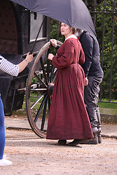 EXCLUSIVE Kate Winslet is seen on set of Ammonite which is currently filming in London. In the scene, the much loved British actress is seen being sick in the street.<br /> <br /> 18 April 2019.<br /> <br /> Please byline: Vantagenews.com