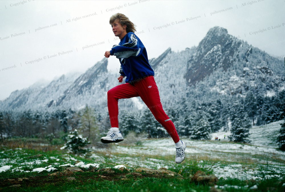 Uta Pippig is a professional athlete, a marathoner and long distance runner from the former East germany.  She has won the Boston Marathon three times and trains in Boulder, Co.  The Flatirons are in the background.