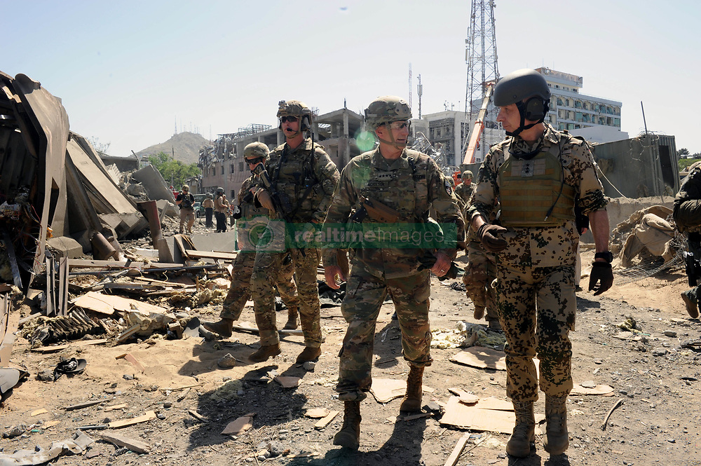May 31, 2017 - Kabul, Afghanistan - U.S. General John Nicholson, Resolute Support commander and RS Chief of Staff Lieutenant General Jurgen Weigt visit the blast site May 31, 2017 in Kabul, Afghanistan. A car bomb was detonated near Zambaq Square outside the Green Zone killing 90 people. (Credit Image: © Egdanis Torres Sierra/Planet Pix via ZUMA Wire)