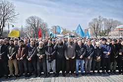 Demonstrators perform prayers for the people killed during the mosque attacks in New Zealand, in Istanbul, Turkey, March 16, 2019. World leaders expressed condolences and condemnation following the deadly attacks on mosques in the New Zealand city of Christchurch, while Muslim leaders said the mass shooting was evidence of a rising tide of violent anti-Islam sentiment. Photo by Kemal Aslan/Depo Photos/ABACAPRESS.COM