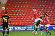 Liam Kinsella of Walsall FC (8) heads the ball during the The FA Cup match between Walsall and Bristol Rovers at the Banks's Stadium, Walsall, England on 7 November 2020.