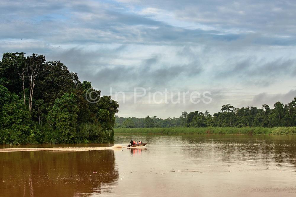 A boat motors up the Kinabatangan River, within the Kinabatangan Wildlife Sanctuary, in Bilit, Sabah, Malaysia, on 9 September 2016.